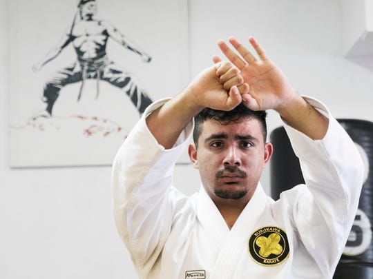 Cape Coral resident Ben Diaz,18, performs a Kata routine while practicing at Kurokawa Martial Arts in Fort Myers. He has a number of black belts (some different degrees) in forms, sparring and weapons.