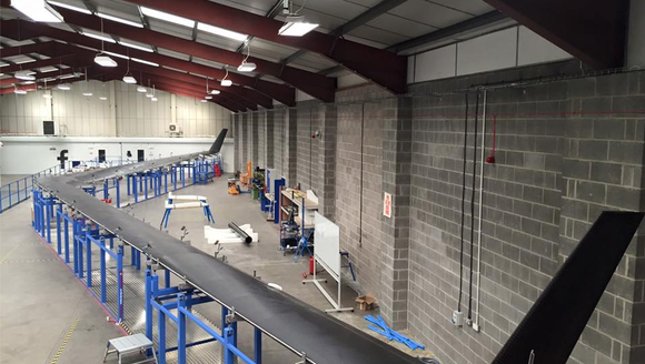 A photo of the first Aquila high altitude aircraft being built by Facebook in England. Facebook said Tuesday it was shutting down the project, four years after its start.