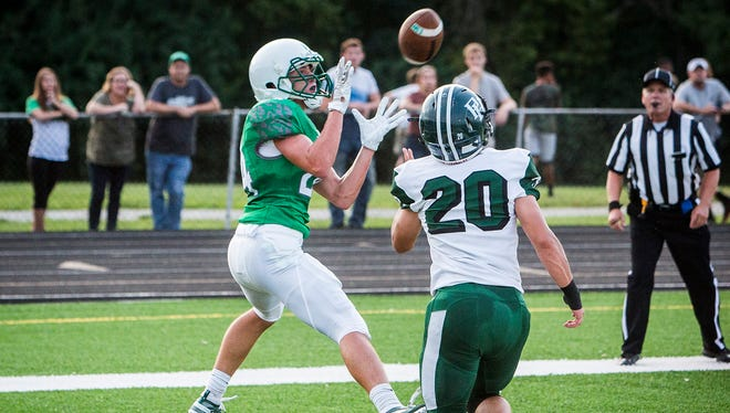 New Castle's Nicholas Grieser catches a touchdown against Pendleton Heights during their game at New Castle High School Friday, Aug. 31, 2018.