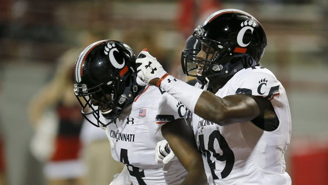 Cincinnati Bearcats safety Malik Clements (4) celebrates after running back an interception for the go-ahead touchdown with just over a minute remaining in the fourth quarter of the NCAA college football game between the Miami Redhawks and the Cincinnati Bearcats at Yager Stadium in Oxford, Ohio, on Saturday, Sept. 16, 2017. The Bearcats won 21-17 after an intercepted RedHawks pass was returned for a touchdown with just over one minute remaining in the game. UC retains the Victory Bell for the 12th-straight year.