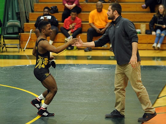 Mardela's Nasir Tucker is congratulated by Snow Hill coach D.J. Draus for his win on Wednesday, Feb. 8, 2017.