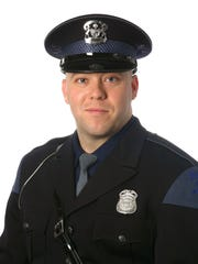 Michigan State Police of Trooper Chad Wolf.