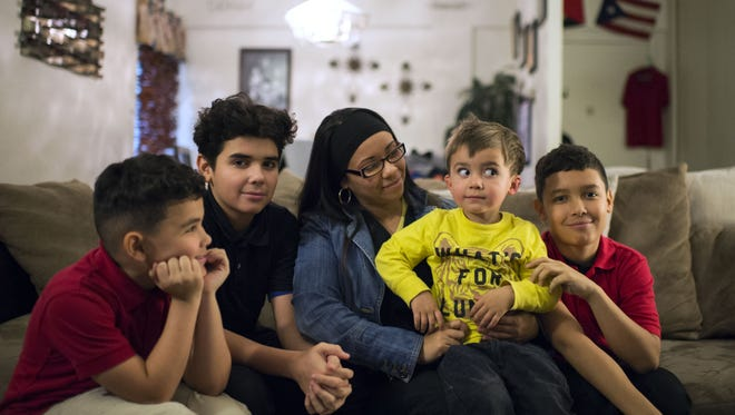 Jessica Quinones with her four children Raymier, Nathias, Ishmael and Yurriel Martinez inside their apartment in Vineland.