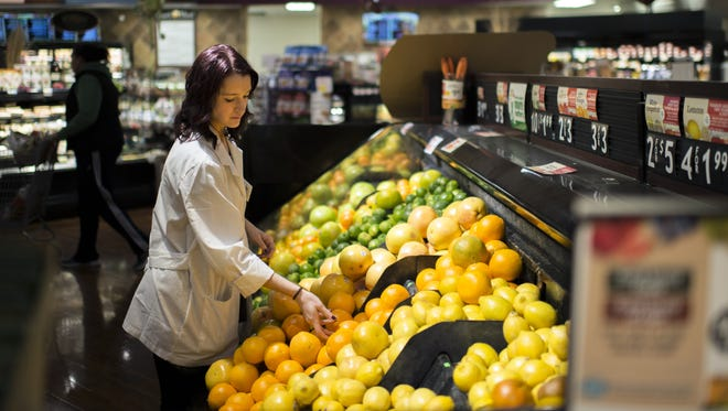 Registered dietitian Jenna Gavigan surveys the produce section of ShopRite on West Landis Avenue in Vineland. Gavigan offers dietary classes in-store.