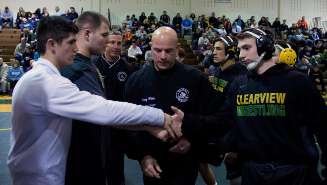 Captains Dillan Taylor, left, and Jim Brady of St. Augustine shake hands with Clearview's Stanley Atkinson before Friday meet at Mullica Hill. The role of captain has always held special importance in wrestling.