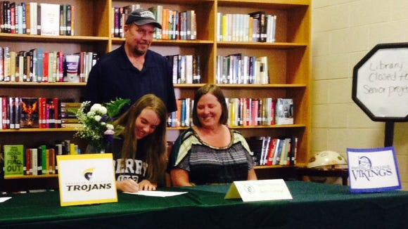 East Henderson senior Molly Horton has signed with the Berry track and field program.