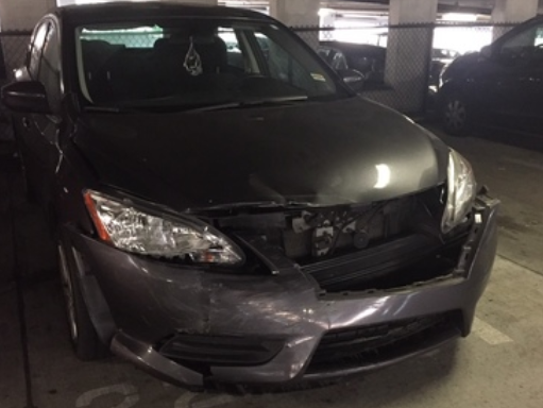 One of the 16 total vehicles damaged in a parking garage.