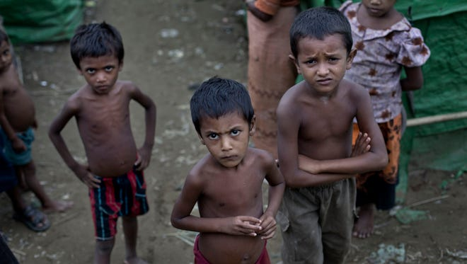 FILE - In this June 24 2014, file photo, Rohingya children gather at the Dar Paing camp for Muslim refugees, north of Sittwe, western Rakhine state, Myanmar. Abdul Razak Ali Artan, the Somali-born student who carried out a car-and-knife attack at Ohio State University on Monday, reported railed on his Facebook account against U.S. interference in countries with Muslim communities. But he specifically protested the killing of Muslims in Myanmar _ also known as Burma _ where the Rohingya ethnic minority faces discrimination and occasional violence from the Buddhist majority and the army and bureaucracy. The Rohingya draw occasional international attention when the violence against them becomes too large to ignore, or when they seek foreign shores as boatpeople in great numbers, but their plight is generally ignored.
