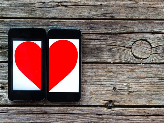 Two Cellphones With Half Heart Symbol