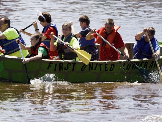 Members of the First United Lutheran team travel safely during the Arts Armada Thursday July 4, 2014, in Sheboygan.