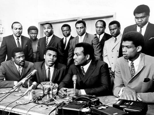 Bill Russell, Muhammad Ali, Jim Brown, Lew Alcindor, Carl Stokes, Walter Beach, Bobby Mitchell, Sid Williams, Curtis McClinton, Willie Davis, Jim Shorter, and John Wooten