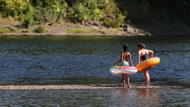 Area residents cool off in the Willamette River as temperatures reach triple digits on Friday, Aug. 19, 2016, at Wallace Marine Park in West Salem.