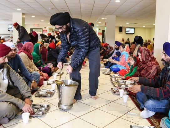 Jasvinder Singh gives out food at Langar, a Sikh religion