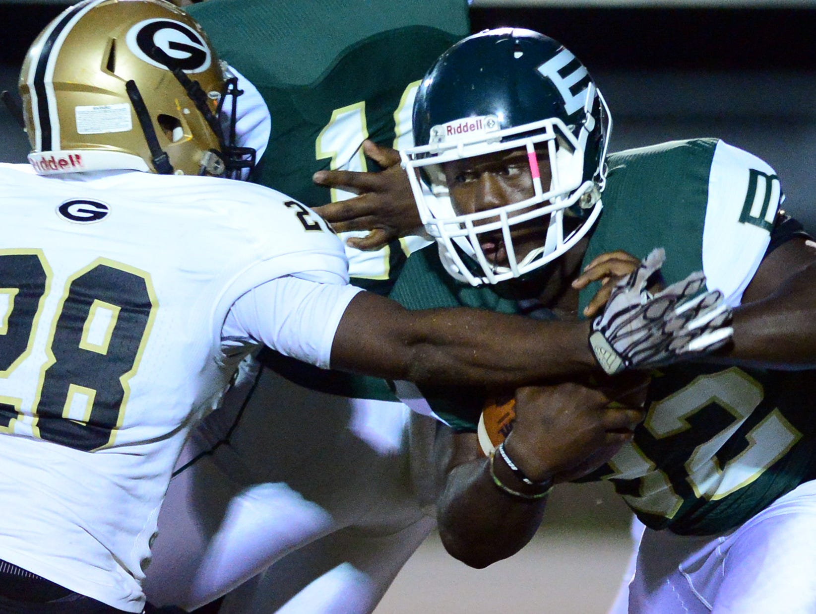Berea High's Kevon Wright (32) is blocked by Greer defense during a football game at Berea on Friday, October 9, 2015.