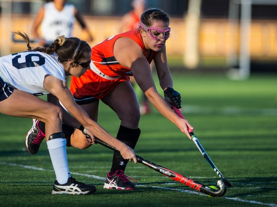 Lexy Smith of Palmyra, right,  battles Penn Manor's Brooke Spezialetti as Palmyra defeated Penn Manor 3-2 in overtime to claim the PIAA District 3 Class 3A title at Milton Hershey on Saturday.