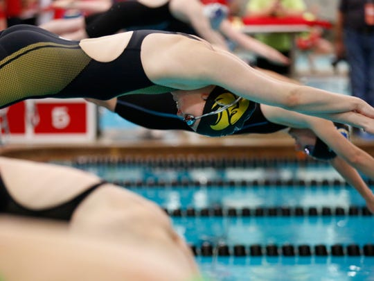Colonel Crawford's Jillian Gregg takes off from the blocks in last year's state swim meet.