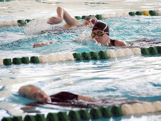 Athletes complete a 500-yard swim during the York YWCA