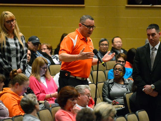 "Michael Alessandroni, a Central York School District parent and principal at Northeastern Middle School, says ""we have never, ever felt that our two students have ever been unsafe,"" during a town-hall-style meeting to discuss school safety following last week's threats, allegedly made by a 13-year-old middle school student, Wednesday, Feb. 28, 2018.  John A. Pavoncello photo"