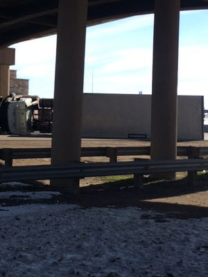 An overturned semi trailer blocked both lanes of northbound Interstate 25 at U.S. Highway 34 for about three hours on Monday.