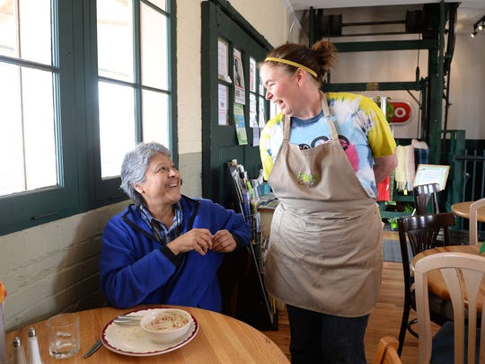 Co-Founder Kathleen Baumgardner, right, talks with Shirl Portillos at FoCo Cafe on Tuesday, April 19, 2016. The nonprofit restaurant runs on volunteer labor and serves meals on a donation basis.
