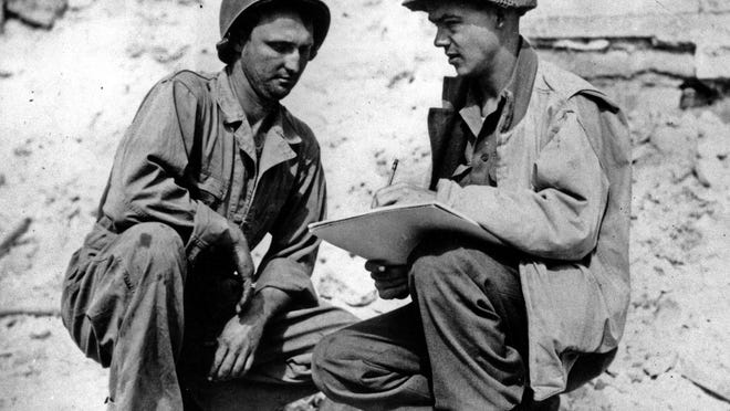 Stars and Stripes artist Sgt. Bill Mauldin sketches Pvt. Robert L. Bowman, left, of Hogansville, Ga., in 1944 on the Anzio beachhead in Italy during World War II. Mauldin's Pulitzer Prize-winning cartoons, with their Willie and Joe characters, used edgy humor to depict the horrors of war and lifted the spirits of U.S. soldiers.