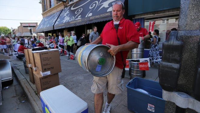 Beer kegs get replenished during Octoberfest 2015 along College Avenue in Appleton