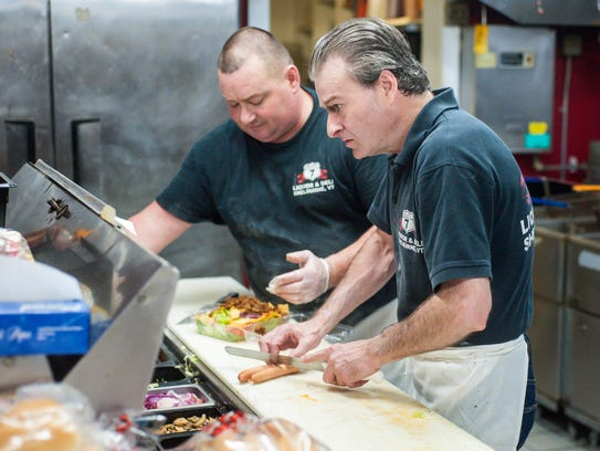 Steve Ward, right, and Chris Ward, fill orders during