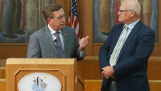 Mayor Mike Huether and Councilor Rex Rolfing speak at a news conference Monday.