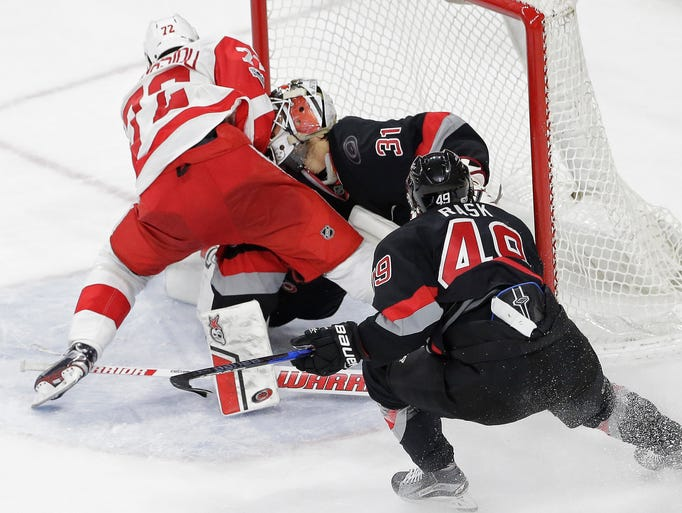 Detroit Red Wings' Andreas Athanasiou collides with