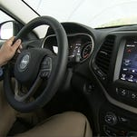 This image from video, taken Oct. 1, 2015, shows Insurance Institute for Highway Safety (IIHS) Senior Research Engineer David Aylor in the drivers seat with an electronic display on the dashboard at the IIHS Vehicle Research Center in Ruckersville, Va. American car buyers are baffled by a blizzard of new safety technologies in vehicles that vary from manufacturer to manufacturer, from model to model, and from one options package to another. (AP Photo/Dan Huff)