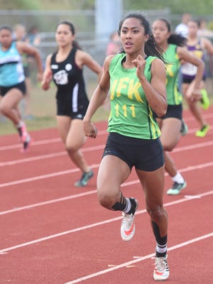Regine Tugade leaves the girls' 100-meter field behind en route to a 12.32 finish at an IIAAG track meet at Okkodo High on May 6.
