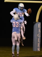 Southern Door senior Nick LeCaptain is lifted by his