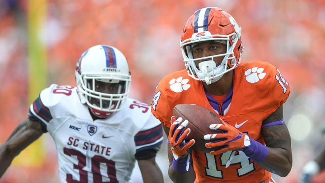 Clemson wide receiver Diondre Overton (14) catches a touchdown past S.C. State defensive back Alex Brown (30) during the 1st quarter on Saturday at Clemson's Memorial Stadium.