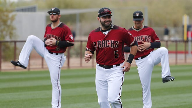 Arizona Diamondbacks catcher Alex Avila (5) warms up during the first day of workouts for pitchers and catchers at Salt River Fields on the Salt River Pima-Maricopa Indian Reservation February 14, 2018.