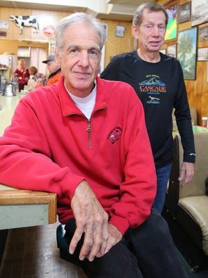 Ted Gross, left, and Mike English, stopped by to support the 17th running of the Cascade Half Marathon in January.