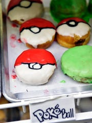 Pokeball-themed doughnuts were for sale at Glazin' in Royal Square on July 16. They were part of a Downtown Inc event tied to the Pokemon Go augmented-reality game.