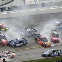 Drivers Greg Biffle (16), Ricky Stenhouse Jr. (17), Clint Bowyer (15), Kyle Larson (42), Tony Stewart (14), Regan Smith (41) and Trevor Bayne (6) crash during the NASCAR Sprint Cup series auto race at Atlanta Motor Speedway, Sunday, March 1, 2015, in Hampton, Ga.