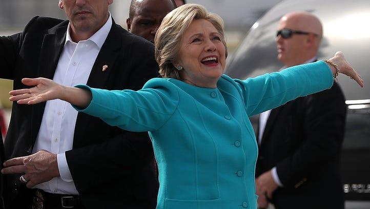 Democratic presidential nominee Hillary Clinton reacts