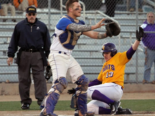 Ephrata's Dillon Good (13) scores on Lampeter-Strasburg catcher Devon Wient (1) during 2nd inning action at Ephrata High School Wednesday April 1, 2015. Chris Knight - GametimePa.com