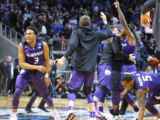Kansas State guard Kamau Stokes and teammates celebrate after defeating Kentucky 61-58 in an NCAA men's college basketball tournament regional semifinal early Friday, March 23, 2018, in Atlanta. (Curtis Compton/Atlanta Journal-Constitution via AP)