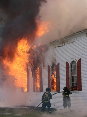 Hebron firefighters battle a fire at St. Paul's Episcopal Church in Hebron. Built in 1773, the church at the time was the oldest wood church still in operation in Wicomico County.