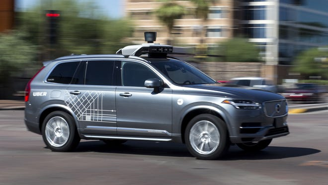 An Uber vehicle cruises in Tempe, Ariz., on Aug. 25, 2017. A self-driving Uber vehicle fatally struck a woman Sunday, March 18, 2018, in Tempe.
