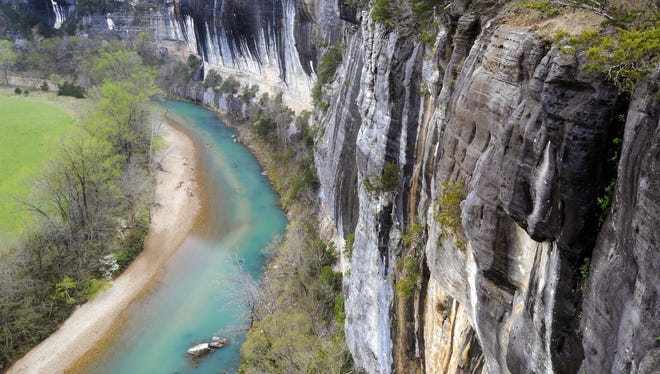 The Buffalo National River flows past Roark Bluff at Steel Creek. The color of the water is a wonder of nature.