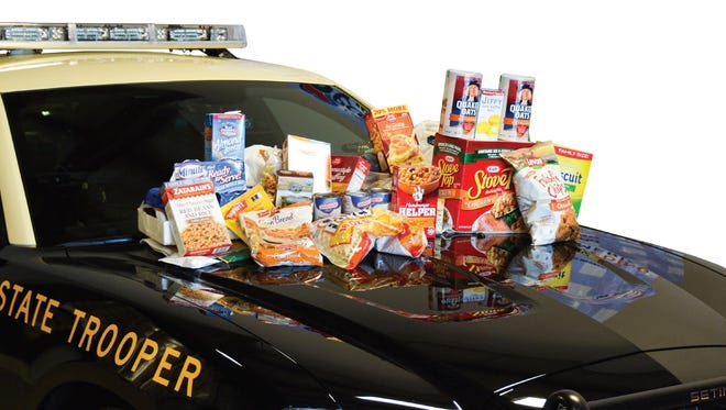 """The Florida Department of Highway Safety and Motor Vehicles along with Florida Highway Patrol are looking for help from the community to """"Stuff the Charger"""" with food donations for families in need."""
