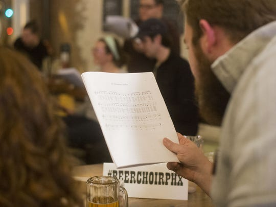 Attendees sing beer-related Christmas carols during