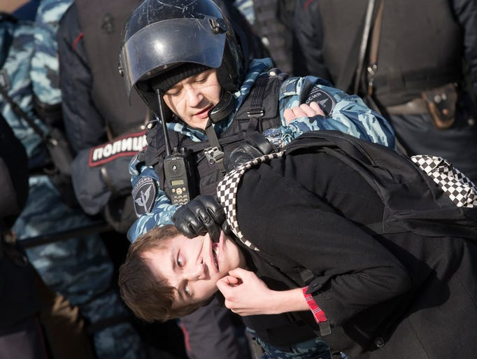 Police detain a protester in downtown Moscow, Russia,