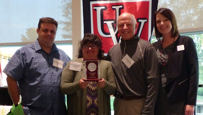 UW-Fond du Lac Regional Associate Dean of Administration and Finance, Bethany Rusch, right, recently presented the university's posthumous 2017 Distinguished Alumni Award to the family of Mary Narges, from left, her children, Rocco Marchionda and Gina Marchionda-Schneider, and her husband, Chuck Narges. Narges attended UW-Fond du Lac from 1980 through 1984. She was honored at the UW-Fond du Lac Foundation's annual donor and scholarship reception held on Sept. 27 in the University Center Commons. This is the 14th year the award has been presented.