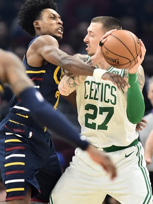Cleveland Cavaliers guard Collin Sexton (2) defends Boston Celtics center Daniel Theis (27) during the first half at Rocket Mortgage FieldHouse on Marh 4, 2020.