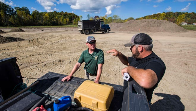 Tom Ayer of the Hinesburg Select Board, left, and general contractor Patrick Miner at the Bissonette Fields construction site on Wednesday, October 5, 2016.