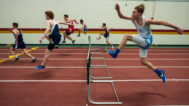Racers make their jumps during the boys 50-meter hurdles during the high school indoor track and field state championships in Northfield on Saturday, February 4, 2017.